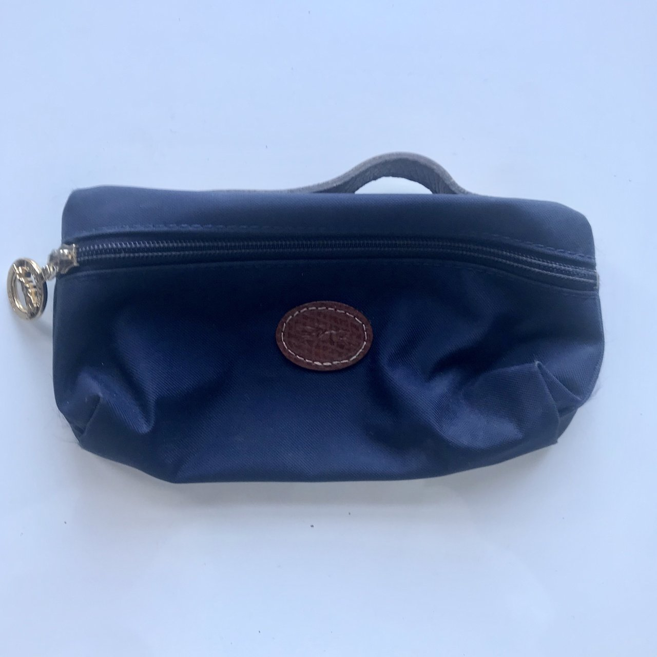 Longchamp Le Pliage navy blue and brown nylon mini makeup   - Depop e5cf0c3d1af11