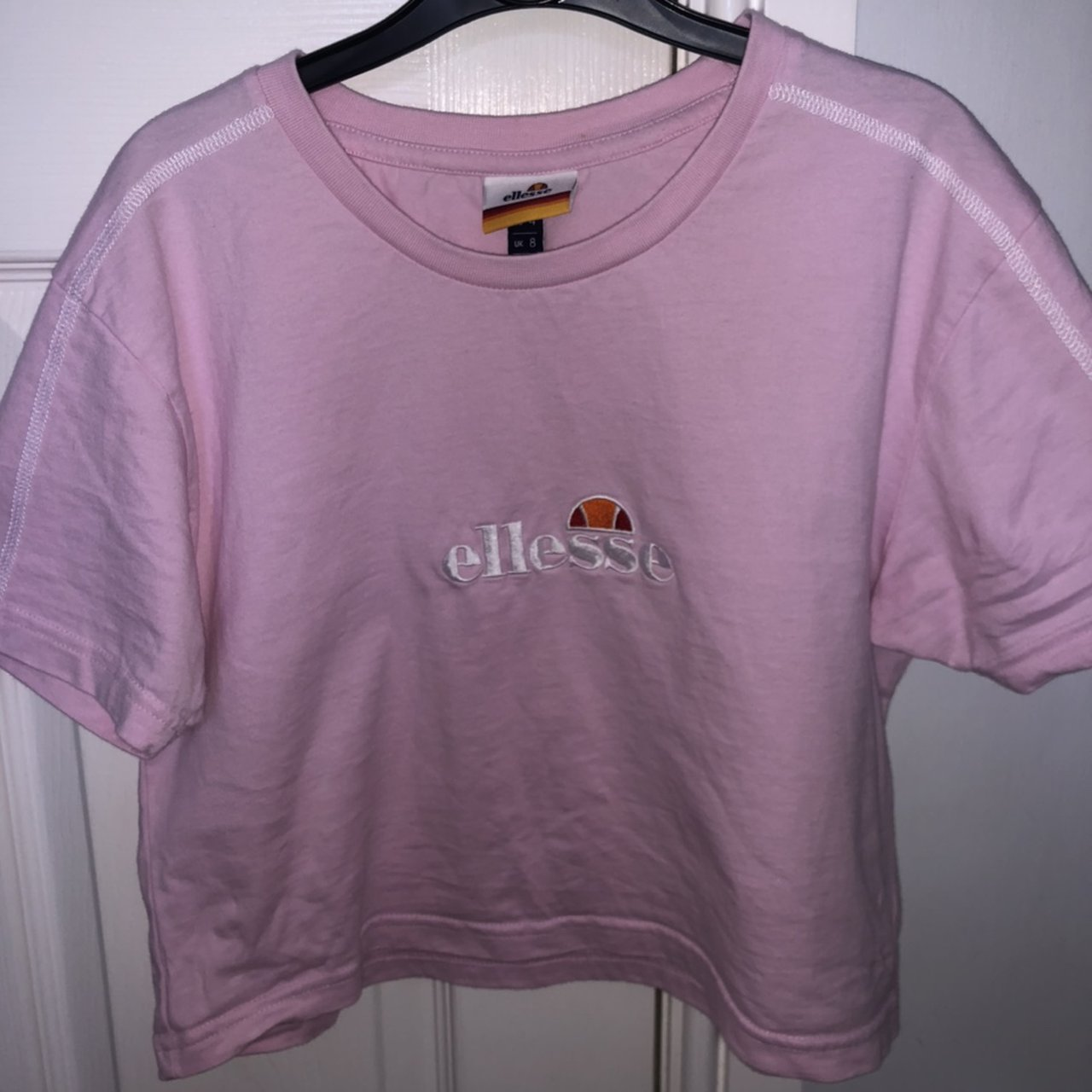 ellesse cropped baby pink t shirt from jd sports depop ellesse cropped baby pink t shirt from