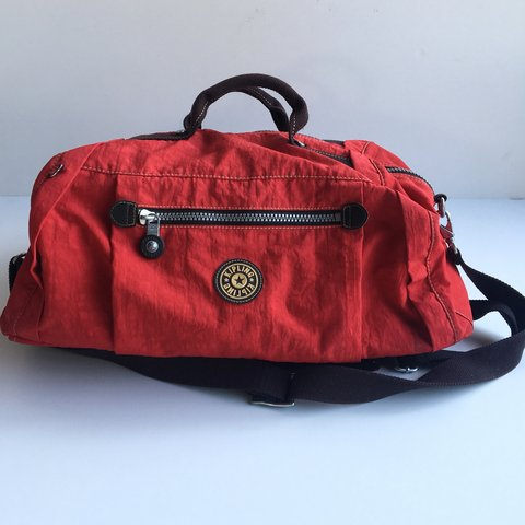 e981995ff @goodsandfinds. 11 months ago. San Francisco, United States. Red Kipling  Duffle Weekend Bag.
