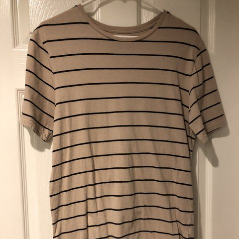 7f5b9df0e073e Pacsun long round ended tshirt tan with horizontal black but - Depop