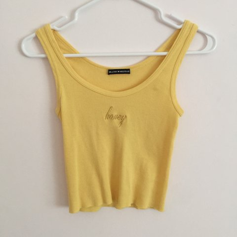 a5ee0710a042dc price drop! Brandy Melville Yellow Sheena Embroidered Tank - Depop
