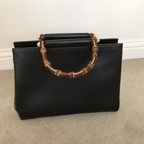 b25dc26fb @zosh87. 3 months ago. Waltham Cross, United Kingdom. Never been used  iconic Gucci handbag with signature bamboo ...