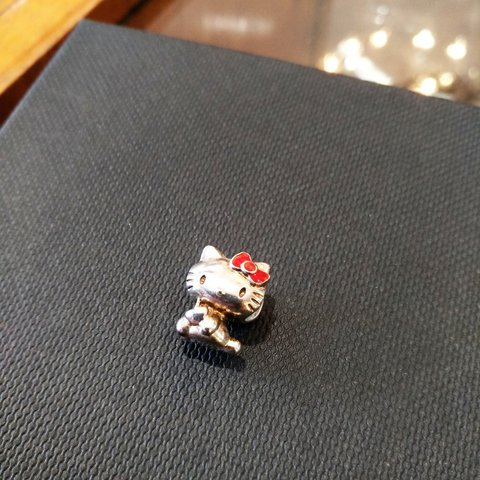d0cc749cb @sparkleandsmile. 9 months ago. Co. Dublin, Ireland. Sterling silver Amore  and Baci Hello Kitty charm.