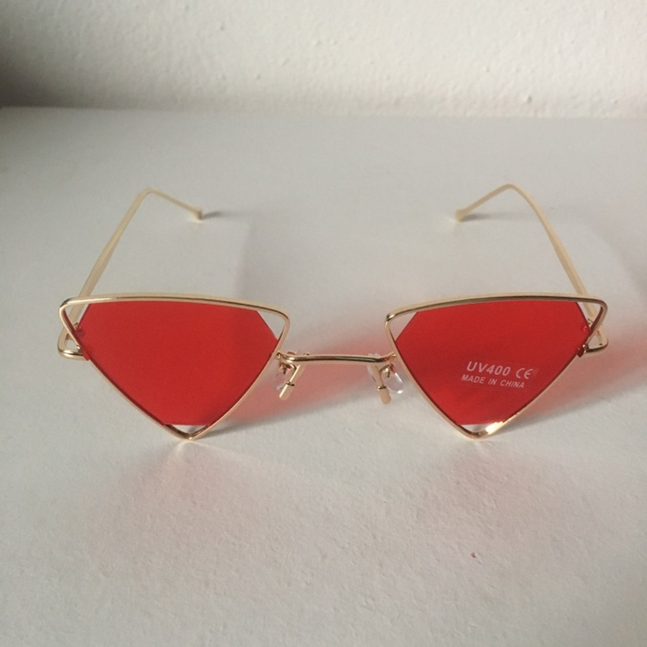 29921344bf Metal triangle sunglasses ▫️Gold frame red tint 2-3 days Uk - Depop
