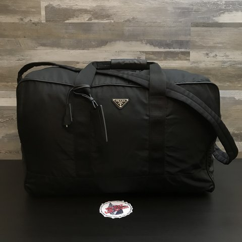 6054bff22f6c @secretlocation. 2 months ago. Los Angeles, United States. Prada Duffle Bag  Comes with Authenticity Cards & Lock